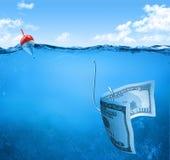 Bill on fishhook Royalty Free Stock Photography
