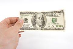 bill för dollar 100 i hand Royaltyfria Foton