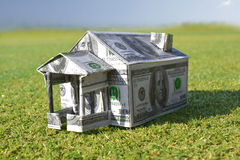 Bill house on grass Royalty Free Stock Photo