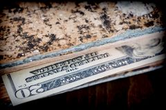 Bill of hundred American dollars hidden in an old book. Conceptual image Royalty Free Stock Photography