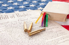 Bill of Rights by bible and bullets. United States Bill of Rights by Bible and bullets Royalty Free Stock Photo