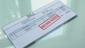 Bill second notice, hand stamping seal on document, payment for services, tariff. Stock footage stock video footage