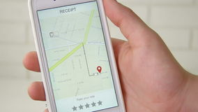 Bill for taxi ride on a smarthpne application rating five stars. Using smartphone application stock video footage