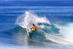 Billabong surfer. Nov. 14: Billabong team rider Tamaroa, performs a frontside maneuver at Backdoor on the North Shore of Hawaii Royalty Free Stock Images