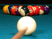 Billards. A billiard stick and cue ball get ready to break (eye level stock image