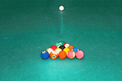 Billards balls. In triangle on the green cloth table Royalty Free Stock Photo