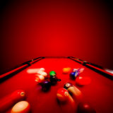Billards pool game. Breaking the color ball. From triangle. Red cloth table Stock Photography