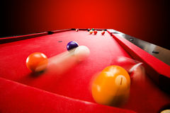 Billards pool game. Breaking the color ball from triangle. Red cloth table Stock Image