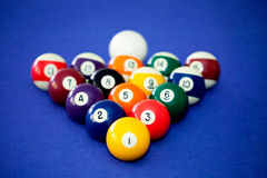 Billards pool game. Color balls in triangle in a blue table Stock Images