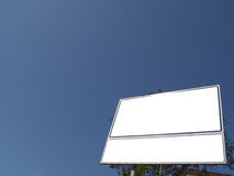 Billboard. With two sections and the blue sky Stock Images