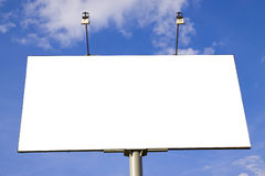 Billboard. Publicity board against the blue sky with clouds royalty free stock image