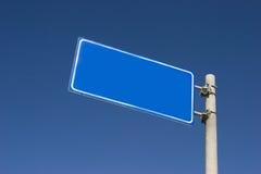 Billboard. Blue billboard up in the blue sky royalty free stock image