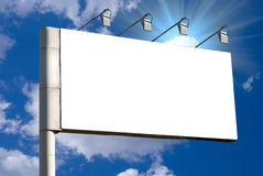 Billboard. Blank billboard over blue sky background royalty free stock image