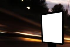 Billboard. Empty billboard at night in city stock image