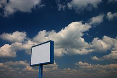 Billboard. Blank billboard against blue sky with white clouds stock photos