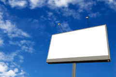 Billboard. Against blue sky with white clouds Royalty Free Stock Image