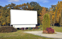 Billboard. White billboard at the park royalty free stock photography