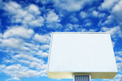 Billboard. A shot of blank billboard against a cloudy blue sky stock photos