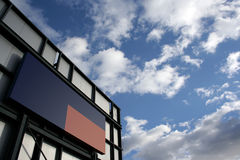 Billboard. Blue and red blank billboard with cloudy sky Stock Image