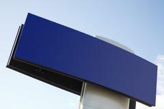 Billboard. An empty billboard on a blue sky stock image