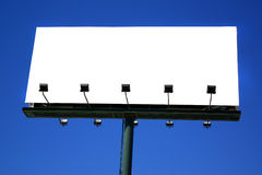 Billboard. Photo of a big blank billboard against a deep blue sky stock image