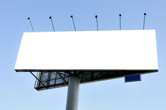 Billboard. Blank big billboard over blue sky, put your own text here stock photo