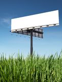Billboard. Blank billboard on grass with blue sky royalty free stock image
