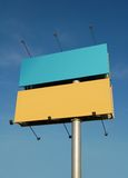Billboard. Light blue and yellow billboard background on clear sky Stock Photo