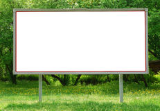 Billboard. With green trees and bushes in the background stock photo