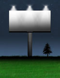 Billboard Advertisement. Brand new billboard displayed at night with lights focusing on the board Royalty Free Stock Photography