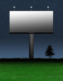 Billboard Advertisement. Brand new billboard displayed at night Stock Photography
