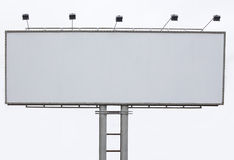 Billboard advertising panel with empty space and light projector Royalty Free Stock Photography