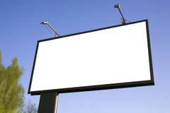 Billboard against the sky. Street big billboard against the blue sky Royalty Free Stock Photos