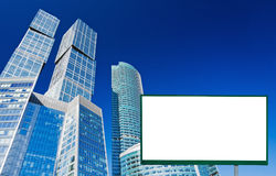 Billboard on the background of skyscrapers Royalty Free Stock Images