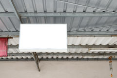 Billboard banner shop signs holding on roof Stock Image