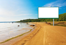 Billboard on the beach. Billboard planted on the sea against the sky royalty free stock photo
