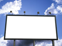 Billboard Blank. Blank outdoor billboard for advertising on blue sky with clouds. White empty space for your text or copy Royalty Free Stock Images