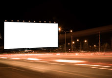 Billboard. Blank billboard on the highway, blank billboard during the twilight light, blank billboard in city background. With clipping path on screen.- can be Royalty Free Stock Image