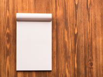 Billboard with blank sheet for notes in abstract blank wooden background. Notebook with empty space Royalty Free Stock Photo