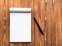 Billboard with blank sheet for notes and pencil in abstract blank wooden background. Notebook with empty space Royalty Free Stock Photo