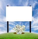 Billboard blank sign with dollars. Concept for advertisement purposes with dollars coming from the ground stock photo