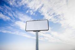 Billboard on a blue sky. Outdoor advertising billboard on a blue morning winter sky Stock Photos