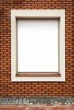 Billboard on brick wall Stock Photography