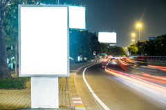 Billboard in the city street, blank screen clipping path included Stock Photos