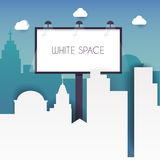 Billboard with copy space text standing high over large city  Royalty Free Stock Images
