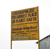 A billboard displaying the rainiest place in earth. A yellow billboard displaying the rainiest place in earth at Cherrapunjee, Meghalaya, India Stock Image
