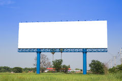 Billboard with empty screen, against blue cloudy sky Royalty Free Stock Images