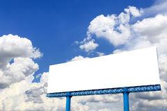 Billboard with empty screen, against blue cloudy sky Royalty Free Stock Image