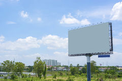 Billboard with empty screen with blue cloudy sky Royalty Free Stock Photo