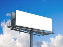 Billboard with empty screen on blue sky Stock Images